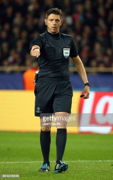 Referee Gianluca Rocchi of Italy gestures during the UEFA Champions League Round of 16 second leg match between AS Monaco and Manchester City FC at...