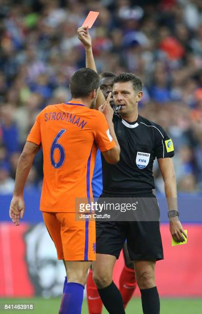 Referee Gianluca Rocchi of Italy gives a red card to Kevin Strootman of the Netherlands during the FIFA 2018 World Cup Qualifier between France and...