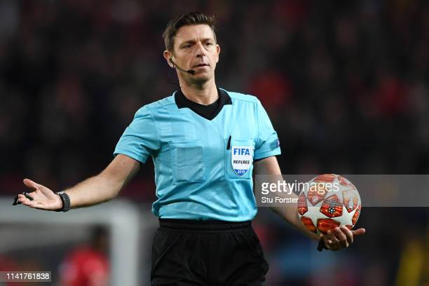 Referee Gianluca Rocchi reacts during the UEFA Champions League Quarter Final first leg match between Manchester United and FC Barcelona at Old...