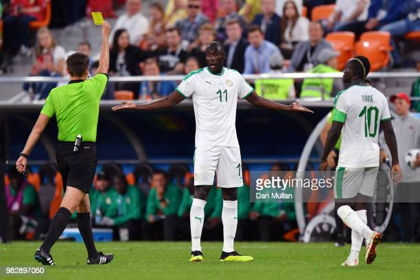 Referee Gianluca Rocchi shows Cheikh Ndoye of Senegal a yellow card during the 2018 FIFA World Cup Russia group H match between Japan and Senegal at...