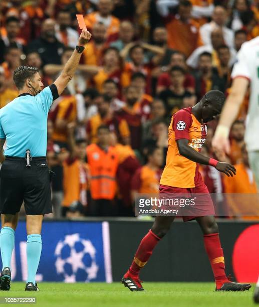 Referee Gianluca Rocchi shows red card to Ndiaye of Galatasaray during UEFA Champions League Group D match between Galatasaray and Lokomotiv Moscow...