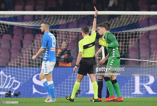 Referee Gianluca Rocchi shows the red card to Alex Meret of SSC Napoli during the Serie A match between SSC Napoli and Juventus at Stadio San Paolo...