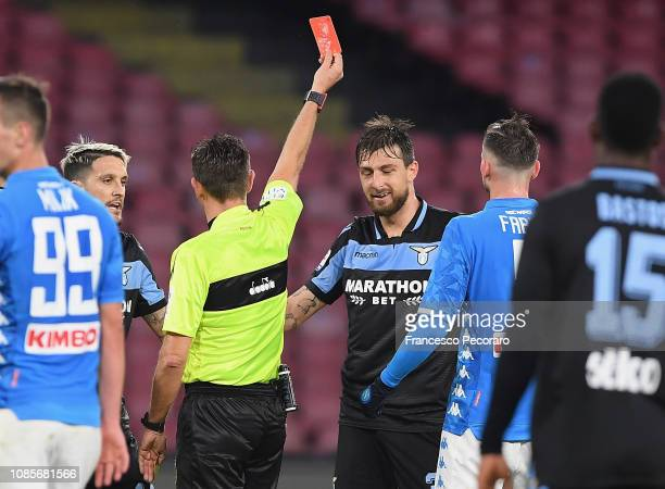 Referee Gianluca Rocchi shows the red card to Francesco Acerbi during the Serie A match between SSC Napoli and SS Lazio at Stadio San Paolo on...