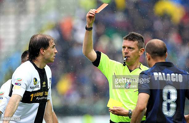 Referee Gianluca Rocchi shows the red card to Gabriel Alejandro Paletta of Parma FC during the Serie A match between Parma FC and FC Internazionale...