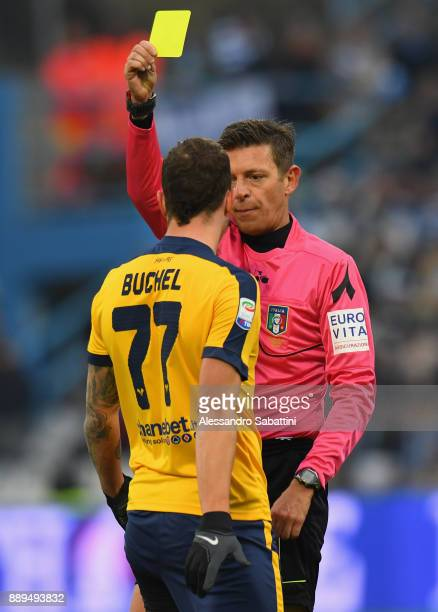referee Gianluca Rocchi shows the yellow card to Marcel Buchel of Hellas Verona during the Serie A match between Spal and Hellas Verona FC at Stadio...