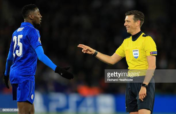 Referee Gianluca Rocchi speaks to Wilfred Ndidi of Leicester City during the UEFA Champions League Quarter Final second leg match between Leicester...