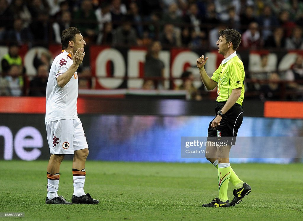 Referee Gianluca Rocchi speaks with Francesco Totti of Roma and suspends the match due to fans' racist chants during the Serie A match between AC Milan and AS Roma at San Siro Stadium on May 12, 2013 in Milan, Italy.