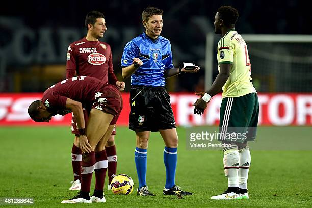 Referee Gianluca Rocchi speaks with Sulley Ali Muntari of AC Milan during the Serie A match between Torino FC and AC Milan at Stadio Olimpico di...