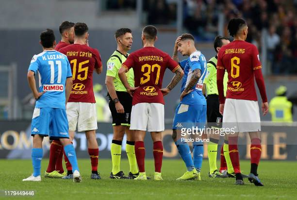 Referee Gianluca Rocchi speaks with the players after the racial slurs of the fans during the Serie A match between AS Roma and SSC Napoli at Stadio...