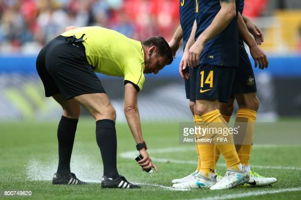 Referee Gianluca Rocchi uses his magic spray during the FIFA Confederations Cup Russia 2017 Group B match between Chile and Australia at Spartak...