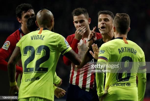 Referee Gil Manzano gestures during La Liga football match between Atletico Madrid and FC Barcelona at the Wanda Metropolitano Stadium in Madrid...