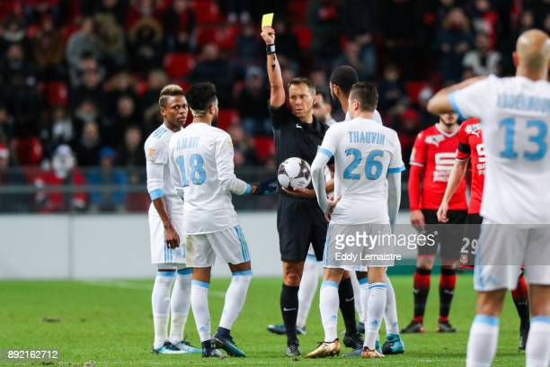 Referee gives a yellow card to Jordan Amavi of Marseille during the french League Cup match Round of 16 between Rennes and Marseille on December 13...