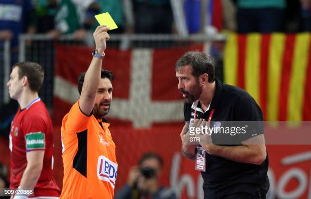 Referee gives a yellow card to Veselin Vujovic head coach of Slovenia during the group II match of the Men's 2018 EHF European Handball Championship...
