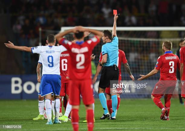 Referee gives Alek'sandr Karapetyan of the Armenia a red card d during the UEFA Euro 2020 qualifier between Armenia and Italy at Republican Stadium...