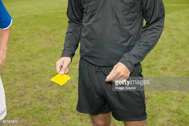 referee giving yellow card - referee stock pictures, royalty-free photos & images