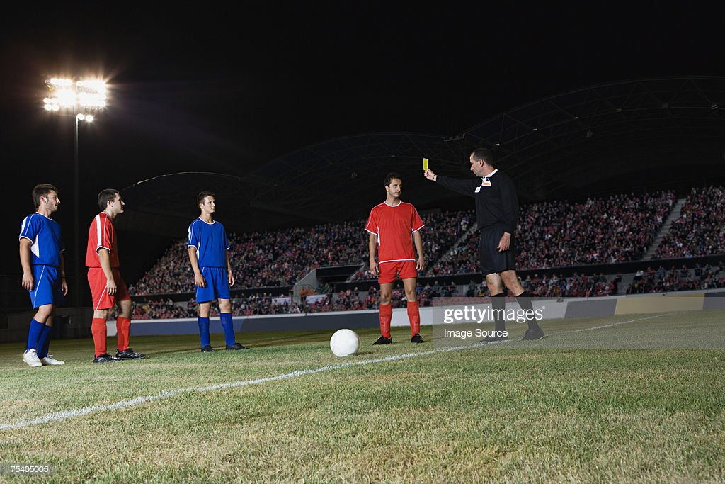 Referee giving yellow card : Stock Photo
