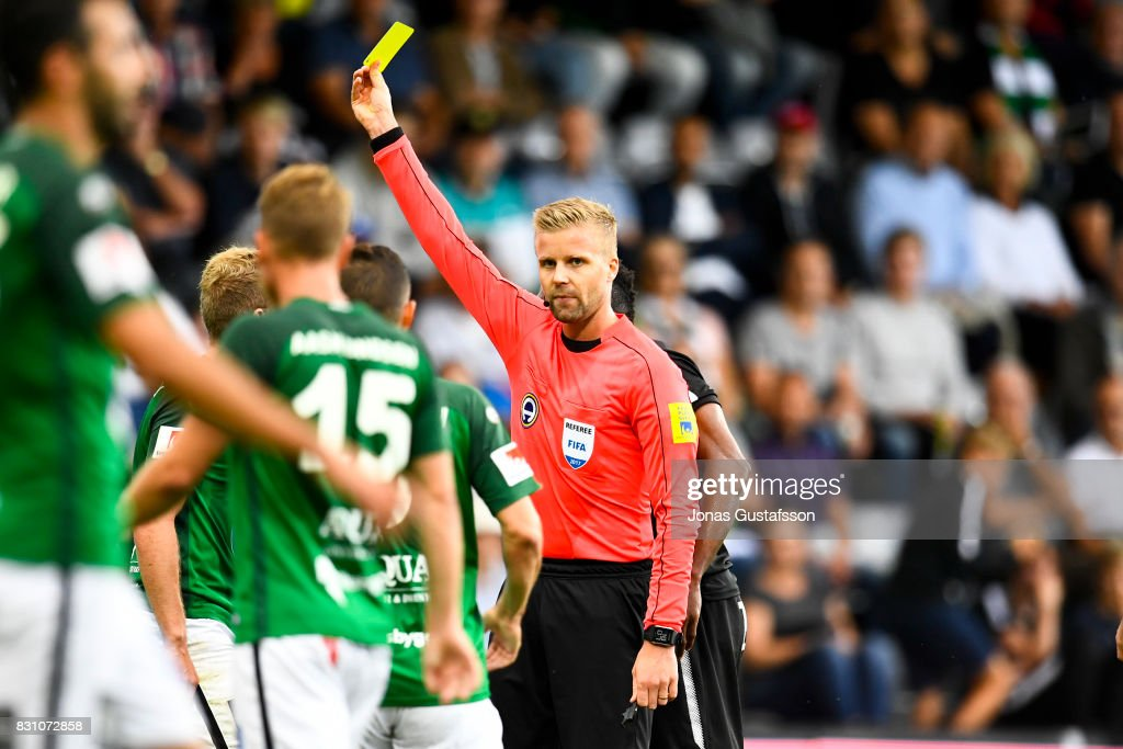 Referee Glenn Nyberg shown a yellow card during the Allsvenskan match between Jonkopings Sodra IF and Orebro SK at Stadsparksvallen on August 13, 2017 in Jonkoping, Sweden.