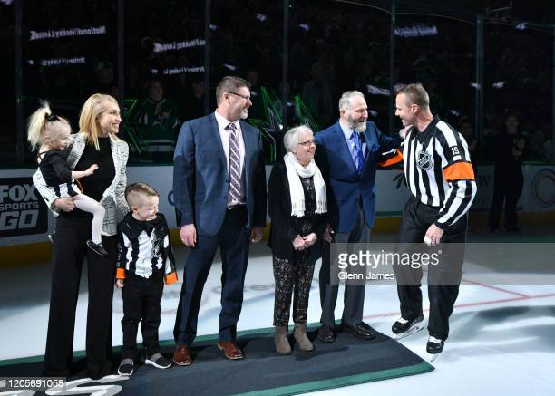 Referee Gord Dwyer celebrates his 1000th NHL game alongside his parents Bob and Bev his brother Randy wife Alexis and kids Bishop and Presley before...