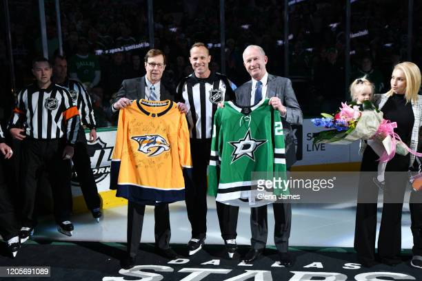 Referee Gord Dwyer is presented with a team signed jersey from Nashville Predators President of Hockey Operations David Poile and Dallas Stars...