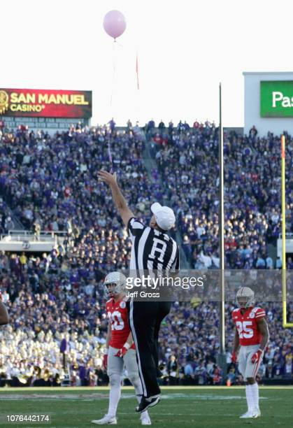 A referee grabs a balloon in the field during the first half in the Rose Bowl Game presented by Northwestern Mutual at the Rose Bowl on January 1...