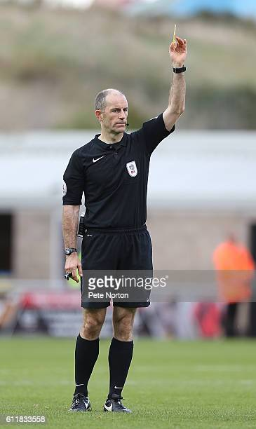 Referee Graham Horwood shows a yellow card during the Sky Bet League One match between Northampton Town and Bristol Rovers at Sixfields Stadium on...