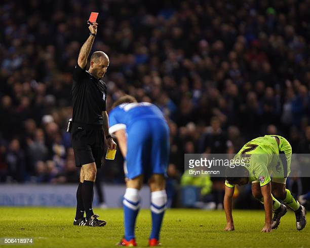 Referee Graham Horwood shows Tommy Smith of Huddersfield Town a red card during the Sky Bet Championship match between Brighton and Hove Albion and...