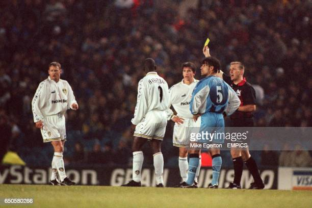 Referee Graham Poll books Leeds United's David Batty on his debut