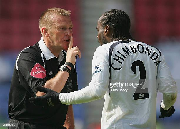 Referee Graham Poll cautions Pascal Chimbonda of Spurs after he hushed the crowd during the Barclays Premiership match between Wigan Athletic and...