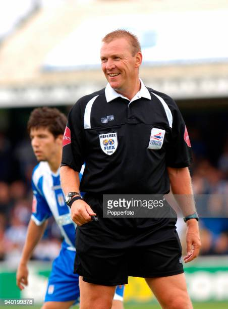 Referee Graham Poll in action during the Championship match between Colchester United and Barnsley at Colchester Community Stadium on August 12 2006