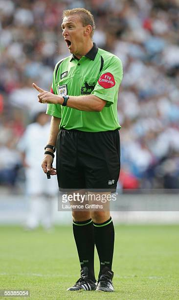 Referee Graham Poll issues a warning during the Barclays Premiership match between Bolton Wanderers and Blackburn Rovers on September 11 2005 in...