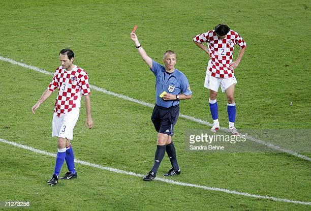 Referee Graham Poll of England shows Josip Simunic of Croatia the red card during the FIFA World Cup Germany 2006 Group F match between Croatia and...