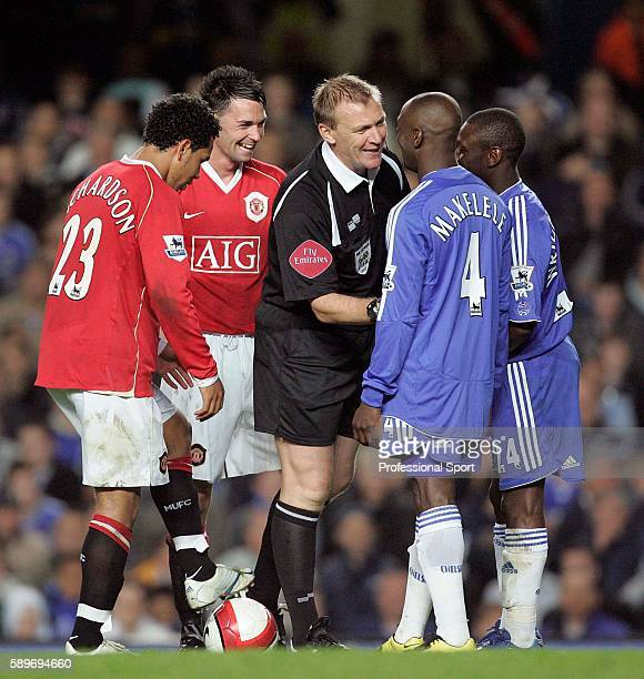 Referee Graham Poll shares a joke with Claude Makelele of Chelsea as Chris Eagles of Mancheter United laughs during the Barclays Premiership match...