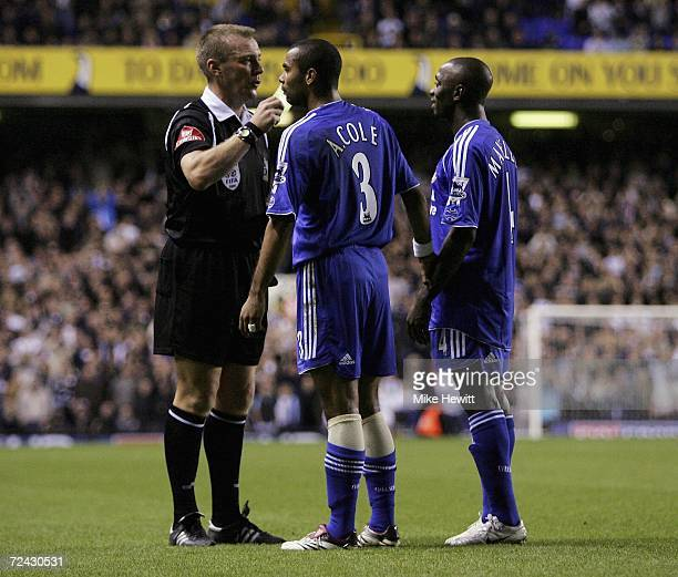 Referee Graham Poll shows both Ashley Cole and Claude Makelele of Chelsea a yellow card during the Barclays Premiership match between Tottenham...