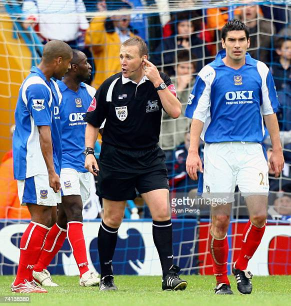 Referee Graham Poll speaks with Portsmouth players after a goal was dissalowed during the Barclays Premiership match between Portsmouth and Arsenal...