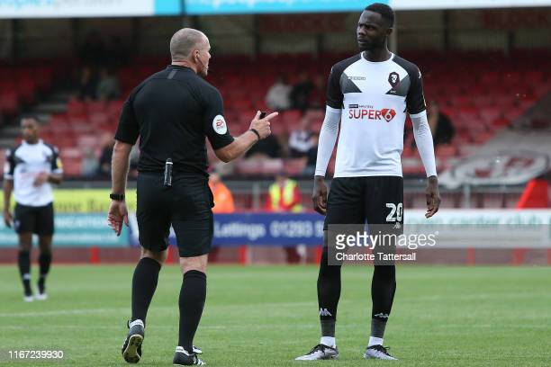Referee Graham Salisbury has words with Emmanuel Dieseruvwe of Salford City during the Sky Bet League Two match between Crawley Town and Salford City...