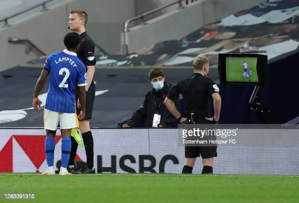 Referee Graham Scott checks VAR after Tariq Lamptey of Brighton and Hove Albion scored his team's first goal during the Premier League match between...
