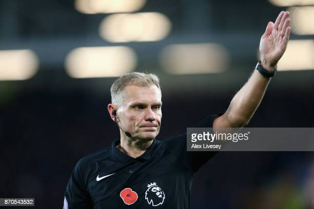 Referee Graham Scott gestures during the Premier League match between Everton and Watford at Goodison Park on November 5 2017 in Liverpool England