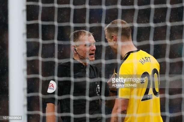 Referee Graham Scott gives a warning to Burnley's English goalkeeper Joe Hart during the English Premier League football match between Tottenham...