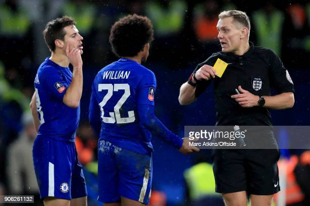 Referee Graham Scott is confronted by Cesar Azpilicueta as he shows a yellow card to Willian of Chelsea for simulation during the Emirates FA Cup...