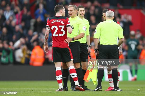 Referee Graham Scott is confronted by PierreEmile Hojbjerg of Southampton following the Premier League match between Southampton FC and Newcastle...