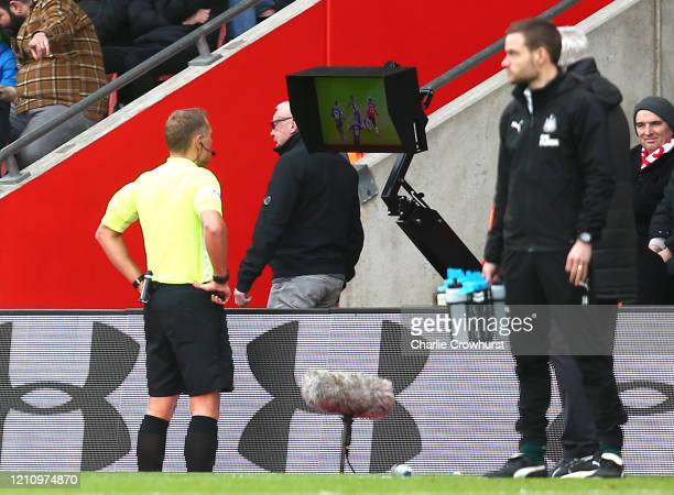 Referee Graham Scott reviews a situation for a red card on the screen during the Premier League match between Southampton FC and Newcastle United at...