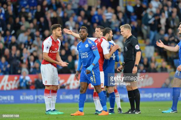 Referee Graham Scott sends off Konstantinos Mavropanos of Arsenal during the Premier League match between Leicester City and Arsenal at King Power...