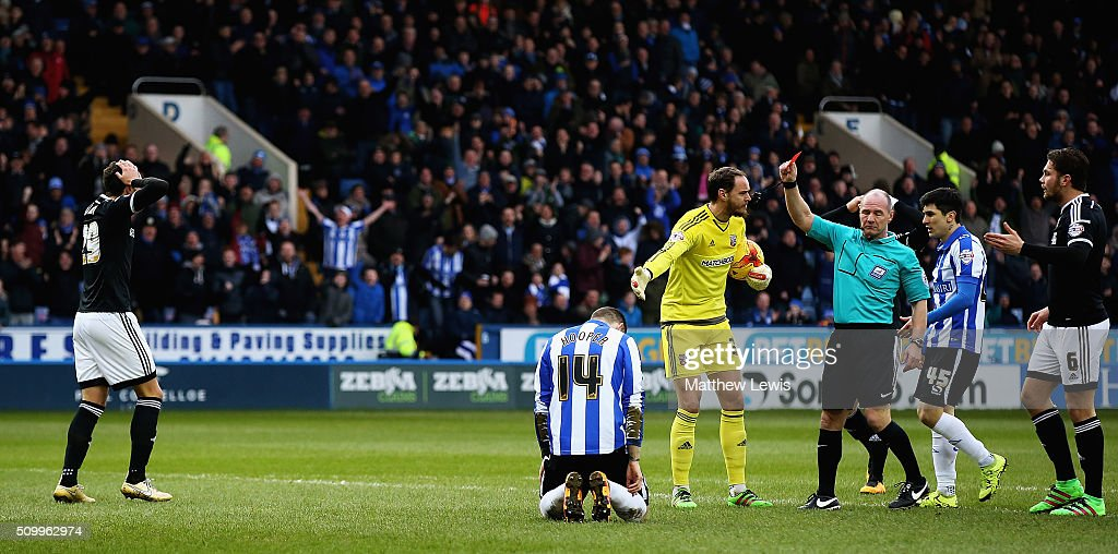 Referee Graham Scott sends off Yoann Barbet of Brentford after his challenge on Gary Hooper of Sheffield Wednesday during the Sky Bet Championship match between Sheffield Wednesday and Brentford at Hillsborough Stadium on February 13, 2016 in Sheffield, United Kingdom.