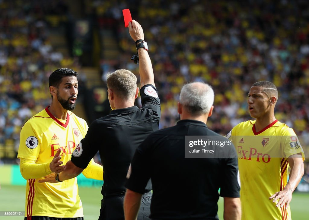 Referee Graham Scott shows a red card to Miguel Britos of Watford during the Premier League match between Watford and Brighton and Hove Albion at Vicarage Road on August 26, 2017 in Watford, England.