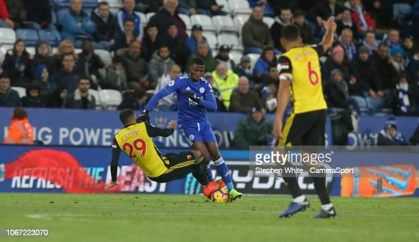 Referee Graham Scott shows a straight red card to Watford's Etienne Capoue for this challenge on Leicester City's Kelechi Iheanacho during the...