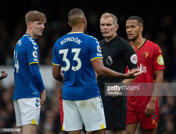 Referee Graham Scott talks to Salomón Rondón and Anthony Gordon of Everton during the Premier League match between Everton and Watford at Goodison...