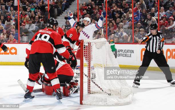Referee Graham Skiliter signals a first period goal by Michael Grabner of the New York Rangers as Craig Anderson, Derick Brassard and Cody Ceci of...