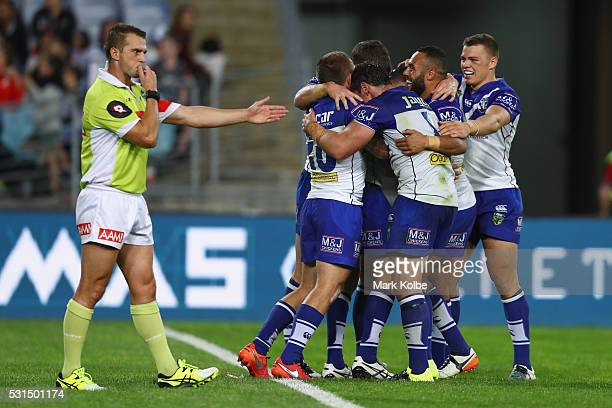 Referee Grant Atkins awards a try as the Bulldogs celebrate with the try scorer Josh Reynolds of the Bulldogs during the round 10 NRL match between...