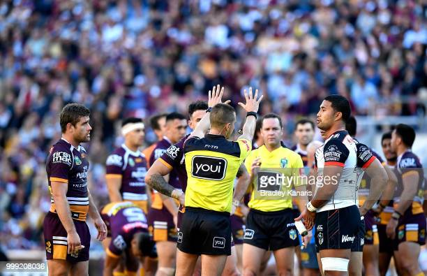 Referee Grant Atkins sin bins Tevita Satae of the Warriors and Andrew McCullough of the Broncos during the round 18 NRL match between the Brisbane...