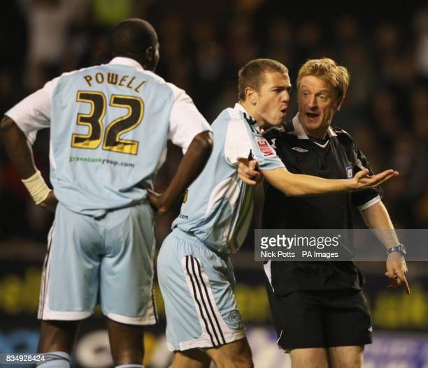 Referee Grant Hegley exchanges words with Derby County captain Paul Connolly after he gives a penalty against Derby County's Darren Powell during the...